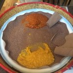 Two side dishes with injera (pancake made from teff)