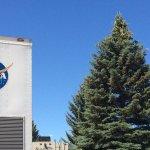 NASA logo and moon behind tree at Mountain View RV Park