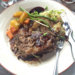 Smoked brisket served with rosemary mashed potatoes - excellent