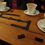 Coffee and dominoes on a rainy afternoon.