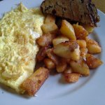 Cheese omelette with hash browns and raisin bread toast