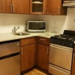 Kitchenette with oven, gas stove, microwave, 2 door mini fridge