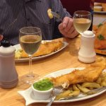 Boneless Haddock Fillet & Chips with mushy peas and a bottle of white wine.