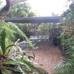 Nice covered BBQ area with picnic tables, nice grill - near the pool
