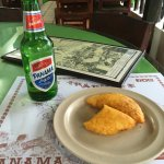 Corn empanada filled with meat and Panama Beer