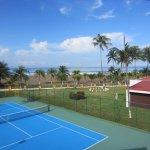 Tennis court, Building with bar, beach couple hundreds feet away