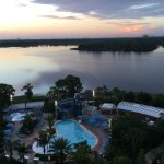 Looking out to pool and Bay Lake at dawn on balcony