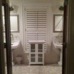 Double Doors Open to Large Bathroom