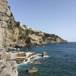 view from cave walk; Praiano on the cliffs at center, hotel bar and beachside at left