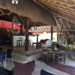 Comfortable seating under a thatched roof patio