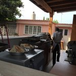 outdoor kitchen with chef Magdi in the background
