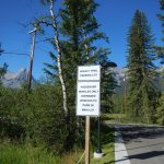 Trailhead sign to dedicated free parking at Canmore trailhead