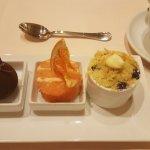 Dessert trio... this is the mascarpone sphere, grapefruit cake, and blueberry cobbler