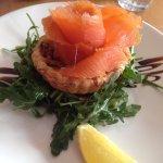 Smoked salmon tartlet with leek & brie on a rocket & pinenut salad