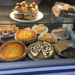 A front view of our cabinet, including quiches, sweets treats, and pies!