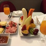 Breakfast of perfectly ripened fruits, fresh juices, cheeses and meats
