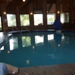 Indoor heated pool you can see the workout room& there is a sauna I think. The bathroom at the p