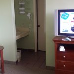 The flat screen television and the vanity area