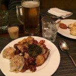 Mixture of items - prawn dumplings, potatoes, chicken, baked fish, etc for breakfast