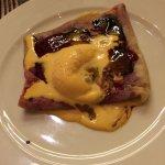 Dessert - crepe with raspberry flavor and mango ice cream
