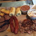 Sharing platter - brisket, corn bread, corn, bbq beans, coleslaw, pulled port and spicy links