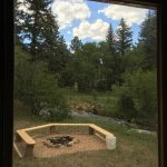 Firepit and creek outside kitchen window