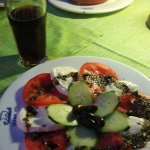 Caprese salad and a pasta dish from Rhodes