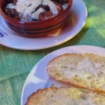 garlic bread and a chicken dish prepared in a local way
