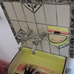 Dedza Pottery is featured in the bathrooms.