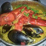 Paella Marina served with lobster, clams, mussels, scallops and shrimp cooked in saffron rice