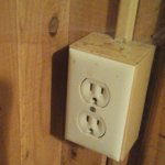 an actual wall outlet in the room, including spider web.