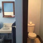 Tiny toilet area, and notice the sink outside (in the main bedroom).