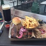 A selection of BBQ: spare ribs, beef brisket, and pulled pork. Firestone Nitro Merlin Milk Stout