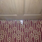 ripped/missing carpet by our door