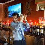 Mixologist, Allen, shaking the heck out of his next martini.