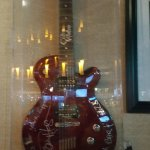 the signed guitar in a case inside the dining area