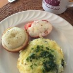 Breakfast course #2 - egg, spinach, and cheese dish with tomato and poppyseed muffin