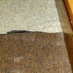 uneven carpet tiles in corridors