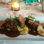 Iberian pork fillet and cheek on a bed of turmeric mash with mushrooms