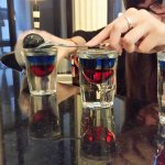 Friendly bartender created red white and blue shots for us