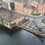 Aerial shot of the venue with outdoor seating and proximity to the canal.