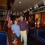 WWII Navy Vet in boat room with his grandson