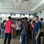 Ghazanfar, my son-in-law, standing in a line for placing an order.