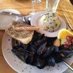 Delicious mussels in a light curry broth