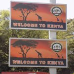 "taken from the front of the hotel-- ""Welcome to Kenya"" signs across the street"