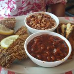 Catfish, side of black-eyed peas, baked beans and texas toast