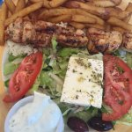 Amazing roast pork with okra and lemon potatoes, tender chicken souvlaki with crispy fries, mout