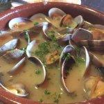 Bowl of clams and yummy, yummy garlic broth...