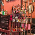 Hot sauce rack at Tooloulou's