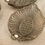 Basketweave dishes waiting to be fired.